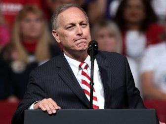"U.S. Congressman Andy Biggs speaking with supporters of President of the United States Donald Trump at a ""Keep America Great"" rally at Arizona Veterans Memorial Coliseum in Phoenix, Arizona."