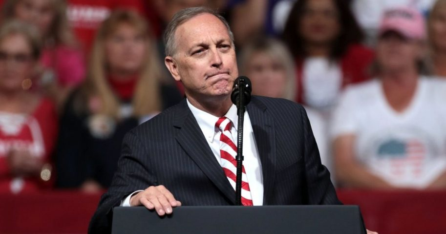 """U.S. Congressman Andy Biggs speaking with supporters of President of the United States Donald Trump at a """"Keep America Great"""" rally at Arizona Veterans Memorial Coliseum in Phoenix, Arizona."""