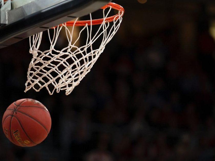 Basketball falling through a hoop