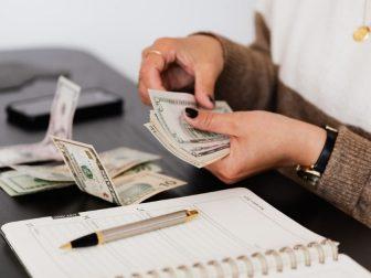 Payroll clerk counting money