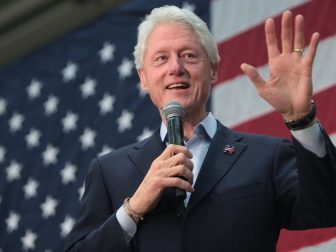 Former President Bill Clinton speaking with supporters at a campaign rally for his wife, former Secretary of State Hillary Clinton, at Central High School in Phoenix, Arizona.