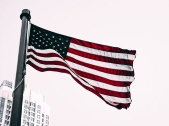 US flag flying in the city