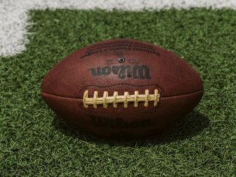 Brown Wilson football on a field