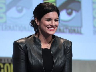 """Ed Skrein and Gina Carano speaking at the 2015 San Diego Comic Con International, for """"Deadpool"""", at the San Diego Convention Center in San Diego, California."""