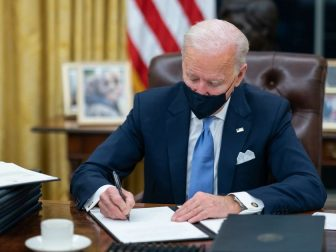 President Joe Biden signs one of the 17 Executive Orders he signed on Inauguration Day Wednesday, Jan. 20, 2021, in the Oval Officeof the White House. (Official White House Photo by Adam Schultz)