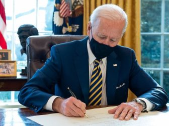 President Joe Biden signs the commission for Lloyd Austin to be Secretary of Defense Friday, Jan. 22, 2021, in the Oval Office of the White House. Lloyd Austin is the first black Secretary of Defense. (Official White House Photo by Adam Schultz)