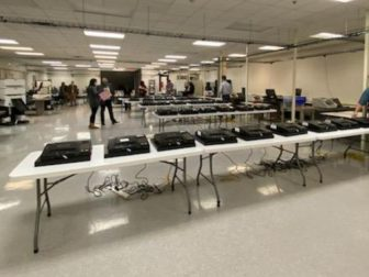 Auditors examine Dominion Voting Systems machines in Maricopa County, Arizona. Officials said Tuesday that audits by two independent firms found the county's Dominion machines were not hacked and accurately counted the ballots in November's elections.