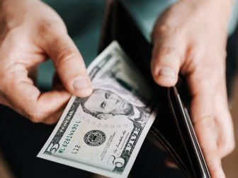 Man pulling money out of a wallet