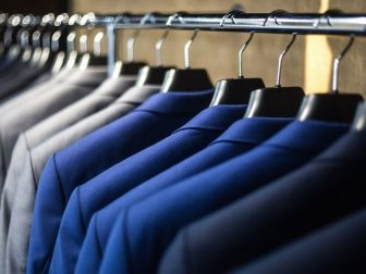 Suit jackets hanging on a rack