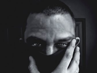 Isolation: Man wearing a mask