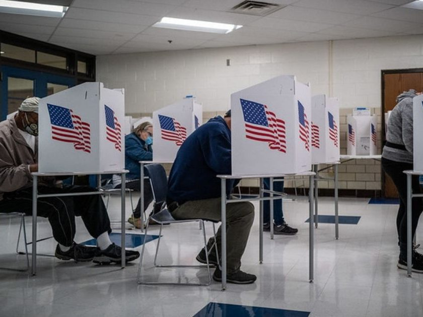 People vote at Callanan Middle School in Des Moines Township, Iowa.