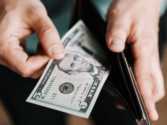 Man pulling cash out of a wallet