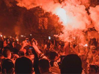 People rioting at night