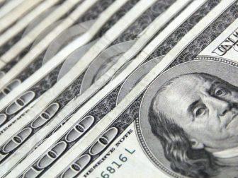 Stack of 100 US dollar bills