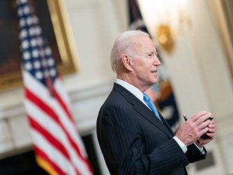 President Joe Biden talks to members of the press in the State Dining Room of the White House Tuesday, March 2, 2021, after delivering remarks during a COVID-19 announcement. (Official White House Photo by Adam Schultz)
