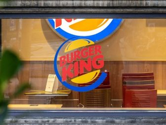 A Burger King located in an old building.