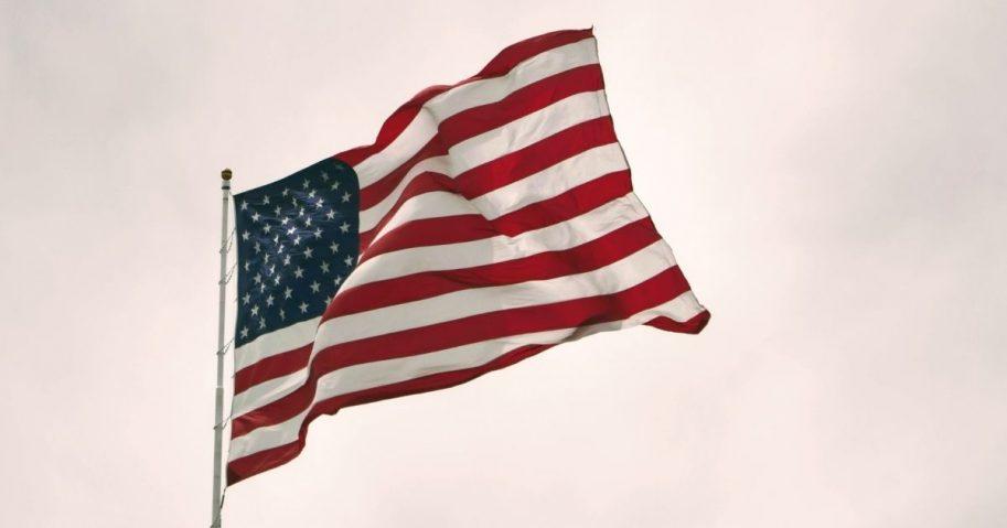 American flag flying against a cloudy sky