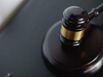 Black gavel on a table