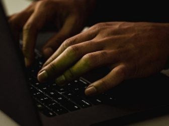 Hands typing on a key board