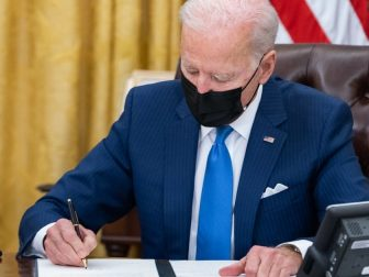 President Joe Biden signs executive orders on immigration Tuesday, Feb. 2, 2021, in the Oval Office of the White House. (Official White House Photo by Adam Schultz)