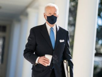 President Joe Biden walks with a cup of coffee Tuesday, March 2, 2021, along the Colonnade of the White House to the Oval Office. (Official White House Photo by Adam Schultz)