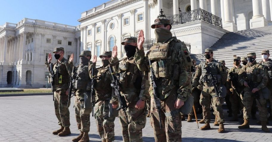 From left: U.S. Army 1st Sgt. Michael Thompson, Spc. Michael Kemerer, Spc. Joseph Haefner, Spc. Daniel Althoff, and Spc. Adam Biemiller, all with Company A, 1st Battalion, 175th Infantry Regiment, Maryland National Guard, swear their oaths of reenlistment outside of the U.S. Capitol building in Washington, D.C., Jan. 22, 2021. At least 25,000 National Guard men and women have been authorized to conduct security, communication and logistical missions in support of federal and District authorities leading up to and through the 59th Presidential Inauguration. (U.S. Army National Guard photo by Capt. Brendan Cassidy)