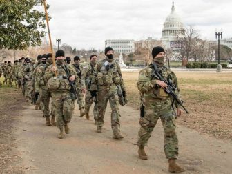 U.S. Army Soldiers assigned to the Virginia Army National Guard's 1st Battalion, 116th Infantry Regiment, 116th Infantry Brigade Combat Team march to their posts near the U.S Capitol building Jan. 17, 2021, in Washington, D.C. At least 25,000 National Guard men and women have been authorized to conduct security, communication and logistical missions in support of federal and District authorities leading up and through the 59th Presidential Inauguration. (U.S. Air National Guard photo by Tech. Sgt. Lucretia Cunningham)