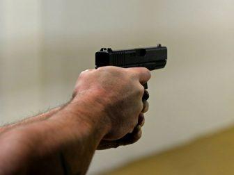 Man aiming a pistol