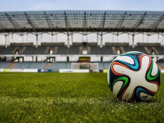 Colorful soccer ball on the field of a stadium