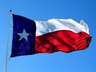 The Texas flag on a clear, windy day