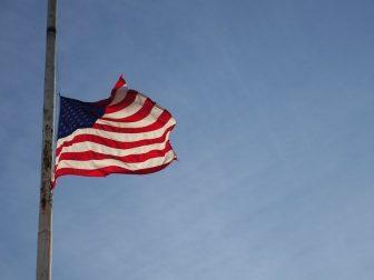 US flag flying half-staff