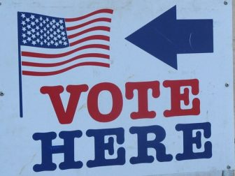 A vote sign sits in the above stock photo.