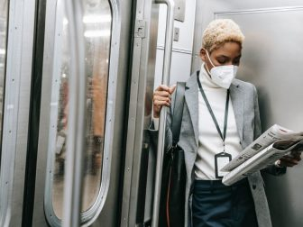 Woman in mask on a subway