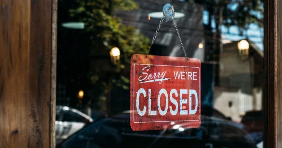 Storefront with a closed sign in the window