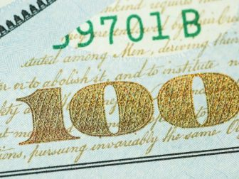 Corner of a US 100 dollar bill