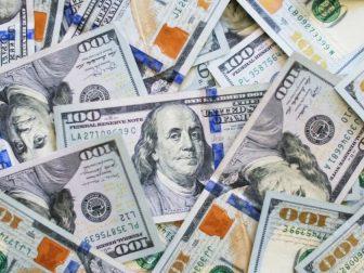 A pile of US 100 dollar bills