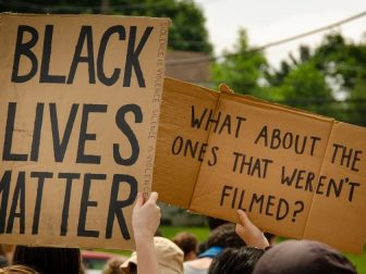 People holding BLM signs in protest