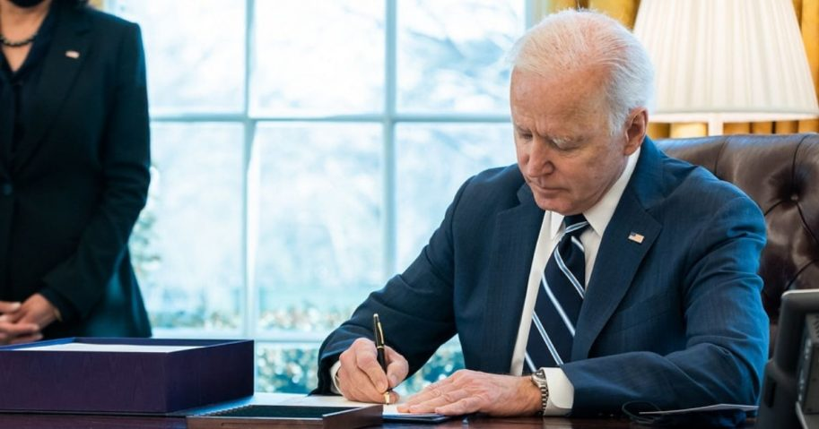 "President Joe Biden, joined by Vice President Kamala Harris, signs H.R. 1319, the ""American Rescue Plan Act of 2021"" Thursday, March 11, 2021, in the Oval Office of the White House. (Official White House Photo by Adam Schultz)"