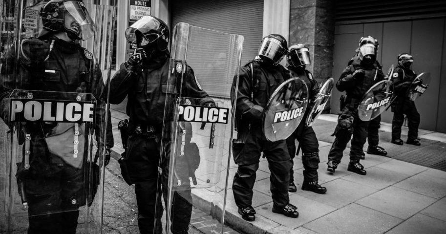 Policemen holding fiber glass shields in Washington D.C.