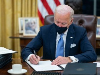 President Joe Biden signs one of the 17 Executive Orders he signed on Inauguration Day Wednesday, Jan. 20, 2021, in the Oval Office of the White House. (Official White House Photo by Adam Schultz)