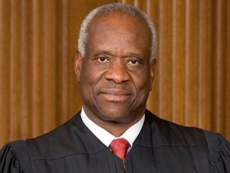 Clarence Thomas' official portrait for the Supreme Court of the United States.