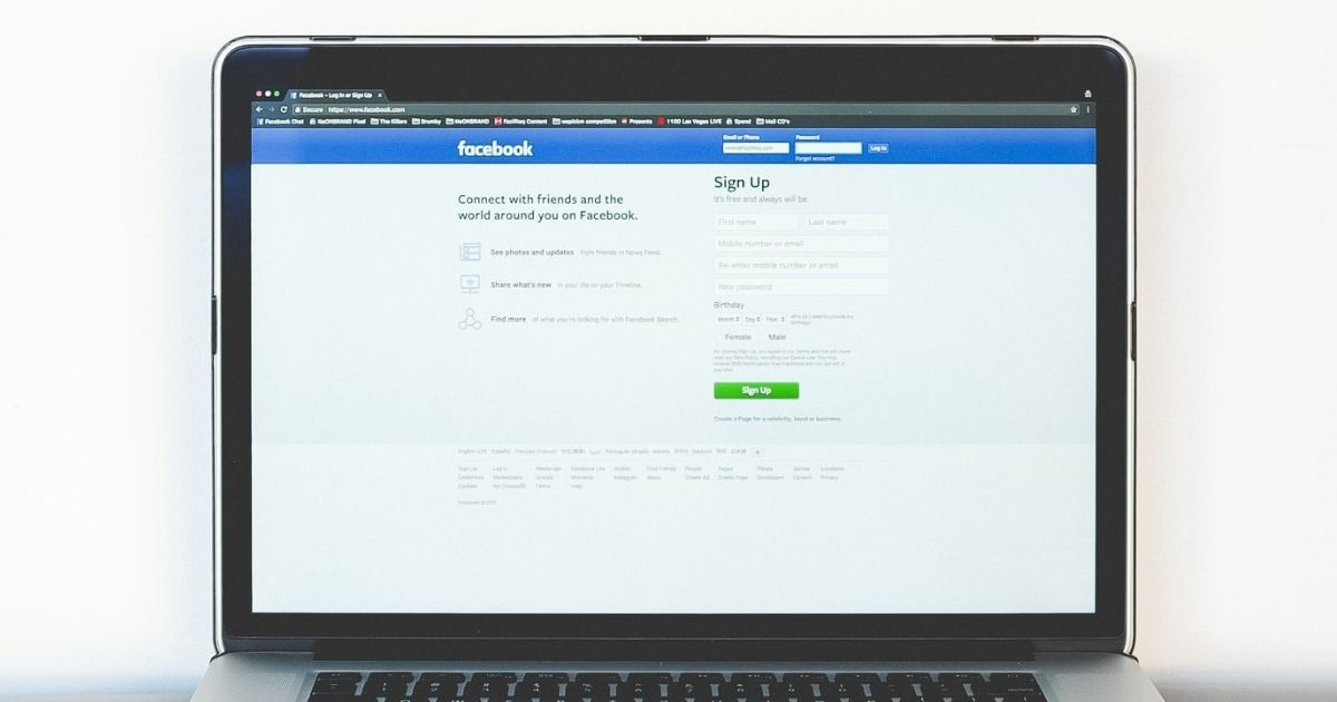 Facebook login page on a laptop screen