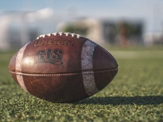 Wilson football sitting on a field