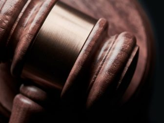 Gavel on black background with copy space.