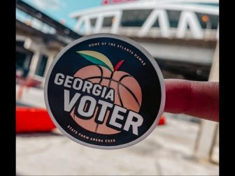 A Georgia voting sticker is pictured outside the State Farm Arena in Fulton County, Georgia.