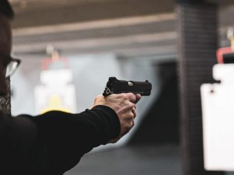 Person using a handgun at an indoor shooting range