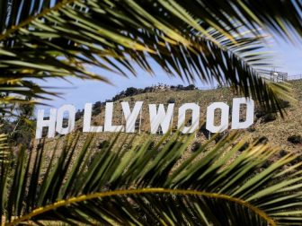 Hollywood sign between palm branches