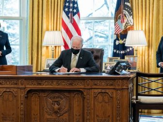 President Joe Biden, joined by Vice President Kamala Harris and Small Business Administrator Isabella Guzman, signs the Paycheck Protection Program Bill Tuesday, March 30, 2021, in the Oval Office of the White House. (Official White House Photo by Adam Schultz)