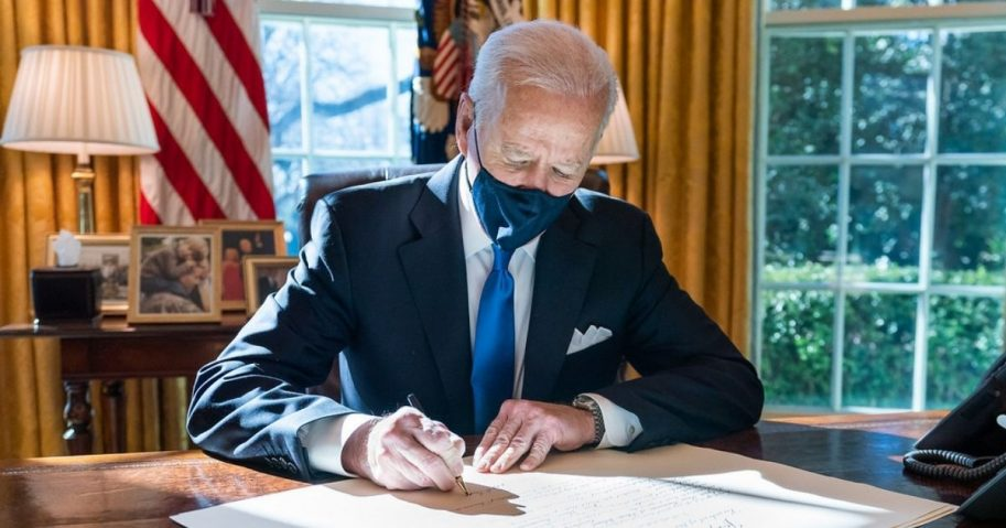President Joe Biden signs a commission for Gina Raimondo as Secretary of Commerce Wednesday, March 3, 2021, in the Oval Office of the White House. (Official White House Photo by Adam Schultz)