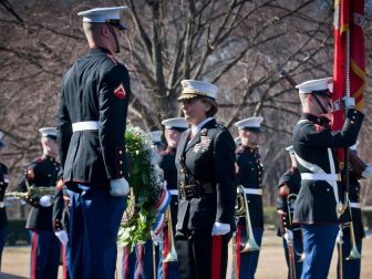 Maj. Gen. Angela Salinas, director of the Marine Corps' Manpower Management Division, and Lance Cpl. Austin Benz, a Marine Corps Body Bearer with Marine Barracks Washington, lay a ceremonial wreath at the Marine Corps War Memorial Feb. 23, 2011. The ceremony marked the 66th anniversary of the flag raising on Mt. Suribachi during the battle of Iwo Jima.